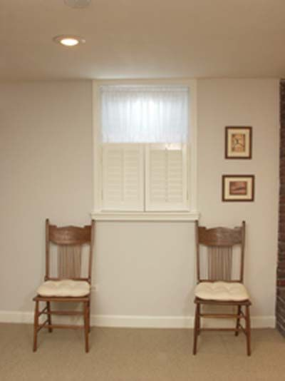 fake a bigger window in a basement use shutters below small window and