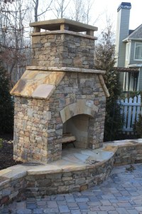 Outdoor Stacked Stone Fireplace with Hearth and Seating ...