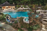 Resembling a tropical resort, this swimming pool and ...