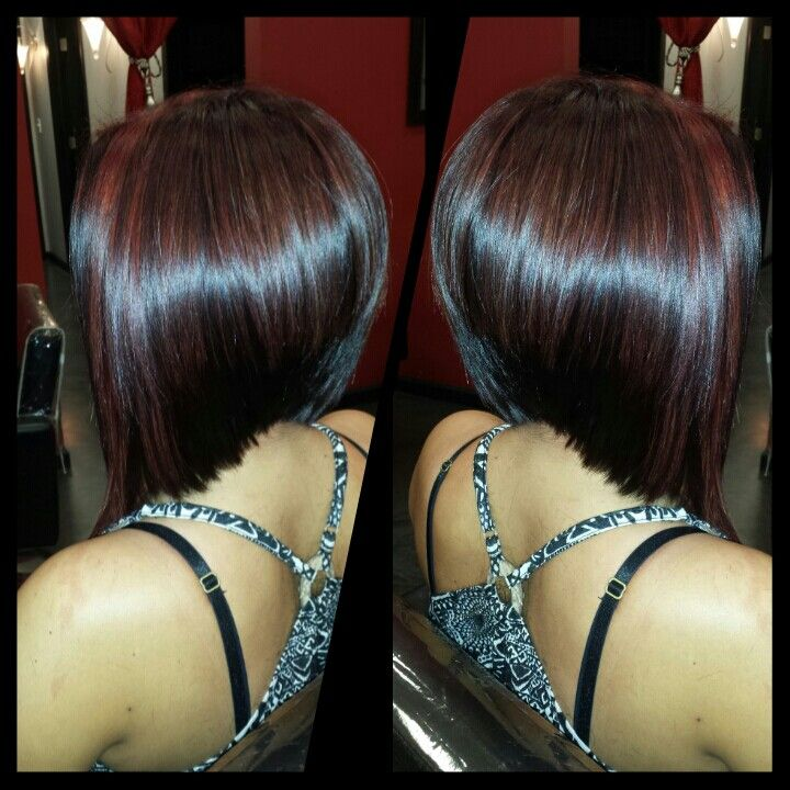 Dark red violet with red highlights and graduated bob haircut created by Geneva Rygel  my work