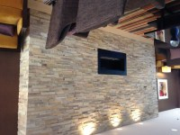 Indoor stone wall with a fireplace | Indoor stone ...