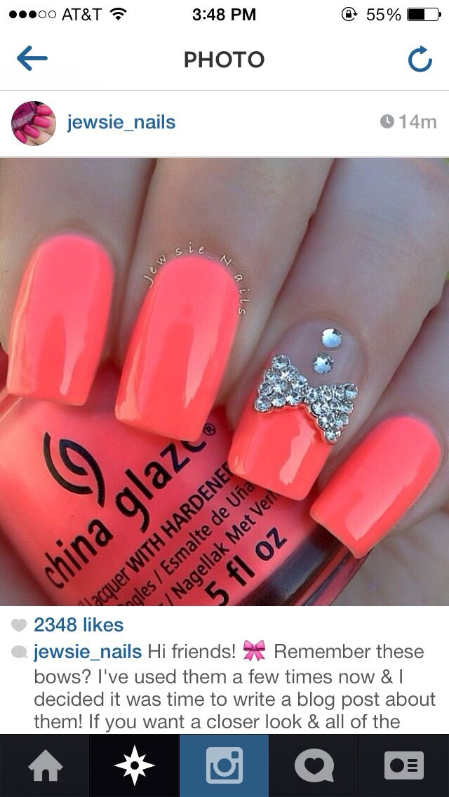 neon pink nails with diamond bow design  Nails