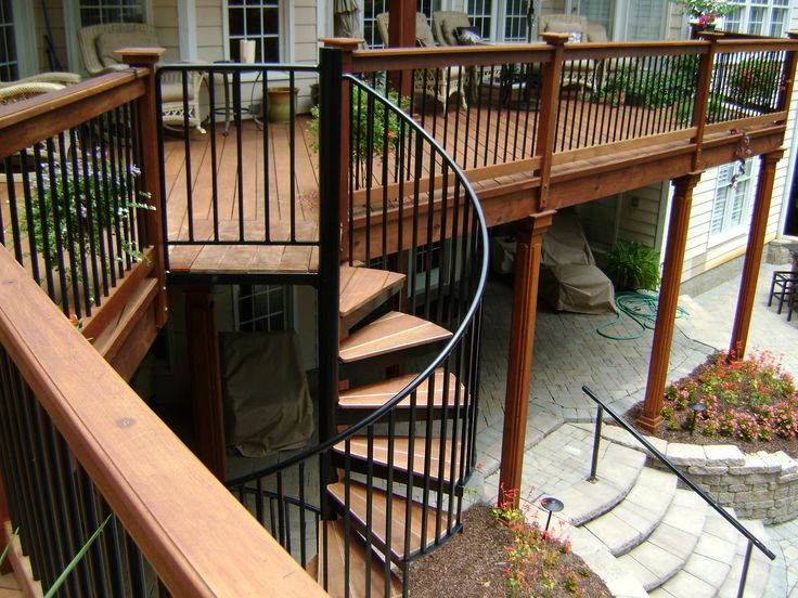 Second story wood deck with spiral staircase and stone patio  Outdoor spaces  Pinterest