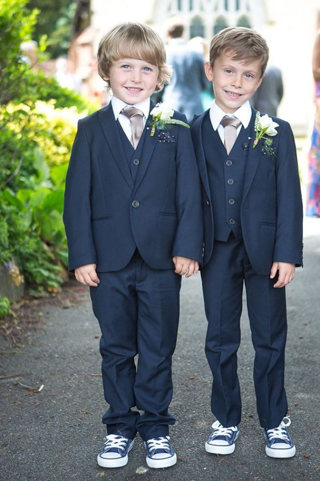 Very smart page boys in suits.  From 'An Elegant Summer Time and Vintage Inspired Gaynes Park Wedding'.  Photography by http://www.dominicwhiten.co.uk/:
