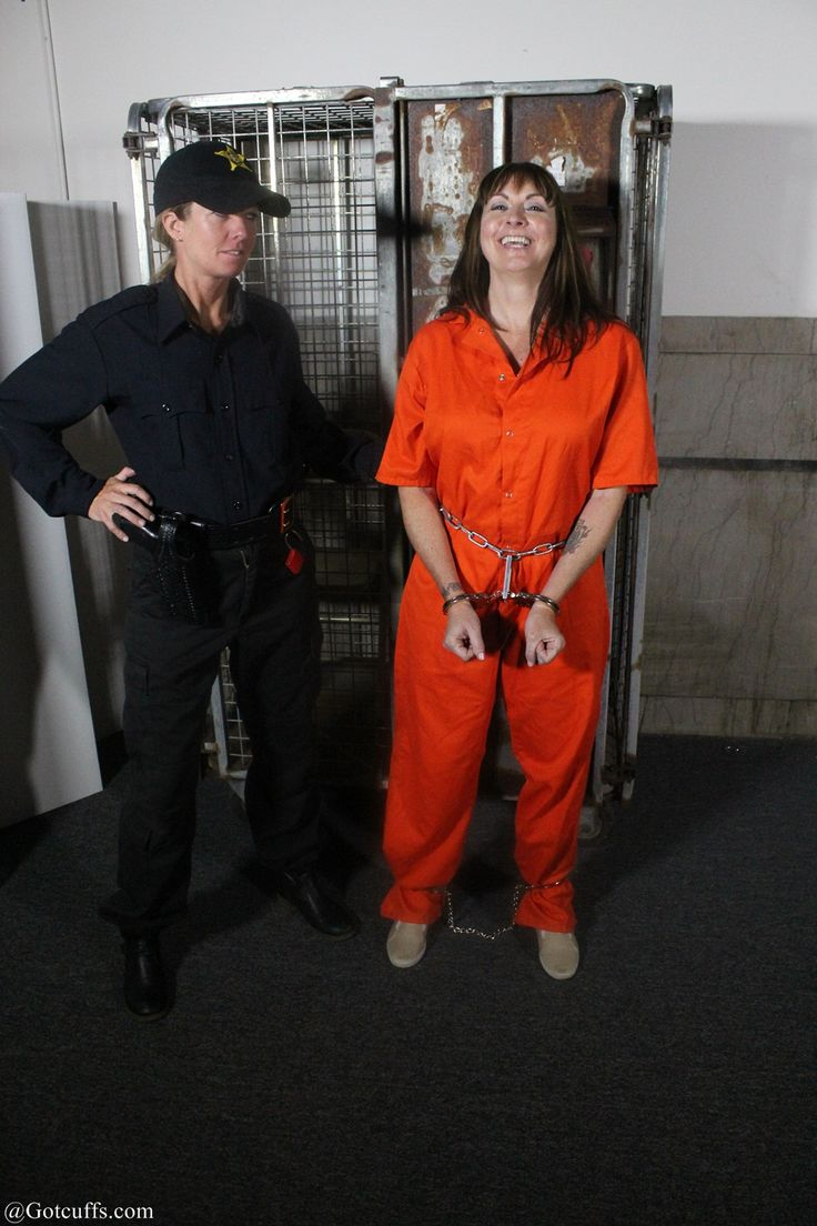 Lauging Woman Shows How Much Fun Wearing Handcuffs And Leg