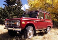 Love this red bronco with the roof rack with the fall ...