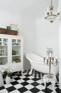 Black and white checkered bathroom tiles make this room ...