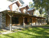 wrap around porch. cement slab, no rails, metal roof ...