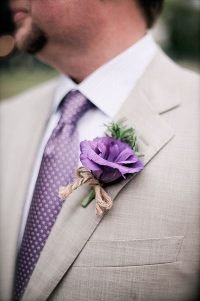 A simple boutonniere using purple lisianthus fresh herbs