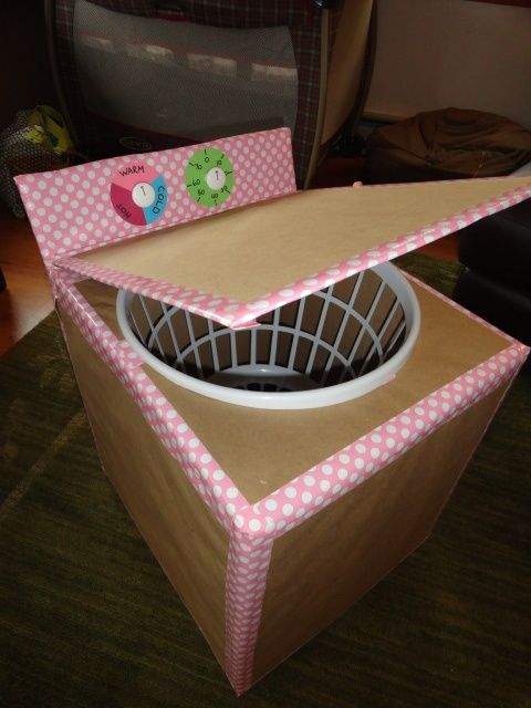 cardboard box brown paper pretty duct tape laundry basket and white knobs  washing machine
