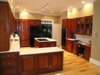 hickory floors, cherry cabinets. Black appliances. Counter ...