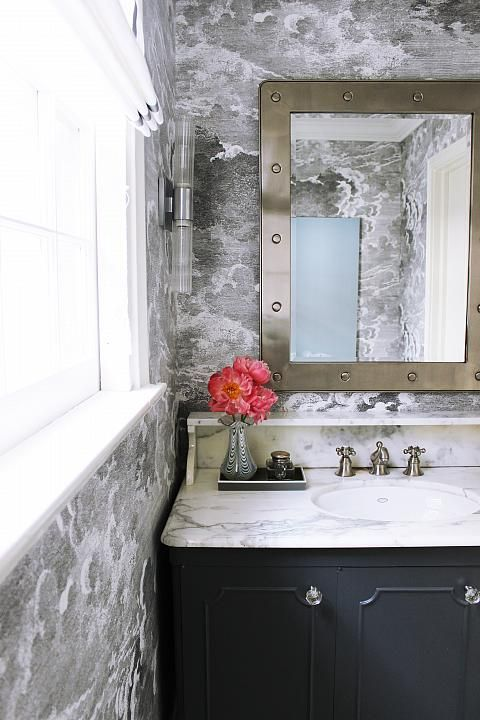 Dare to be dramatic and give your powder room a moody