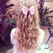 curly hair with pink bow