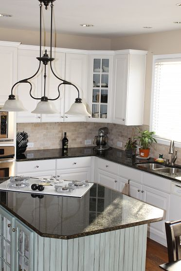 Kitchen  Stove in island The white and Corner cabinets