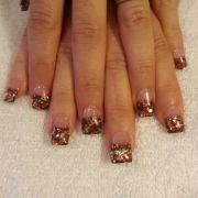 brown glitter with gold and orange