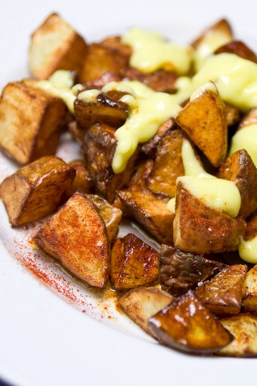 Patatas Bravas with Garlic Allioli — We started a tradition last year of having Spanish Tapas for Christmas.  This looks very