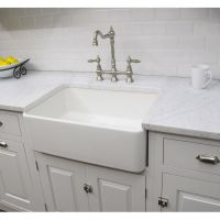 Constructed of fireclay, this large bathroom sink has a ...