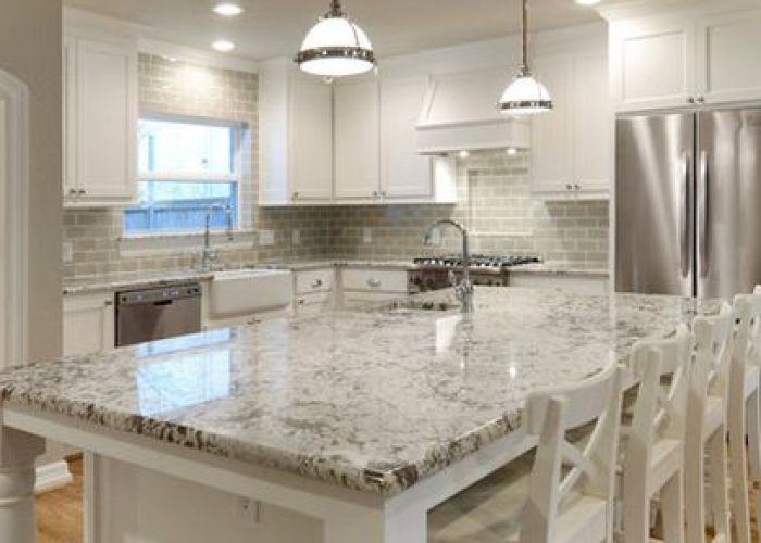 White granite countertops and glass subway tile backsplash but with dark grey cabinets also