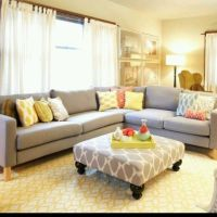 Grey and yellow living room. Love the oversize ottoman ...
