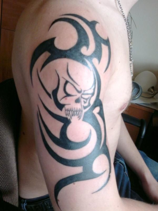 big tribal skull tattoo arm