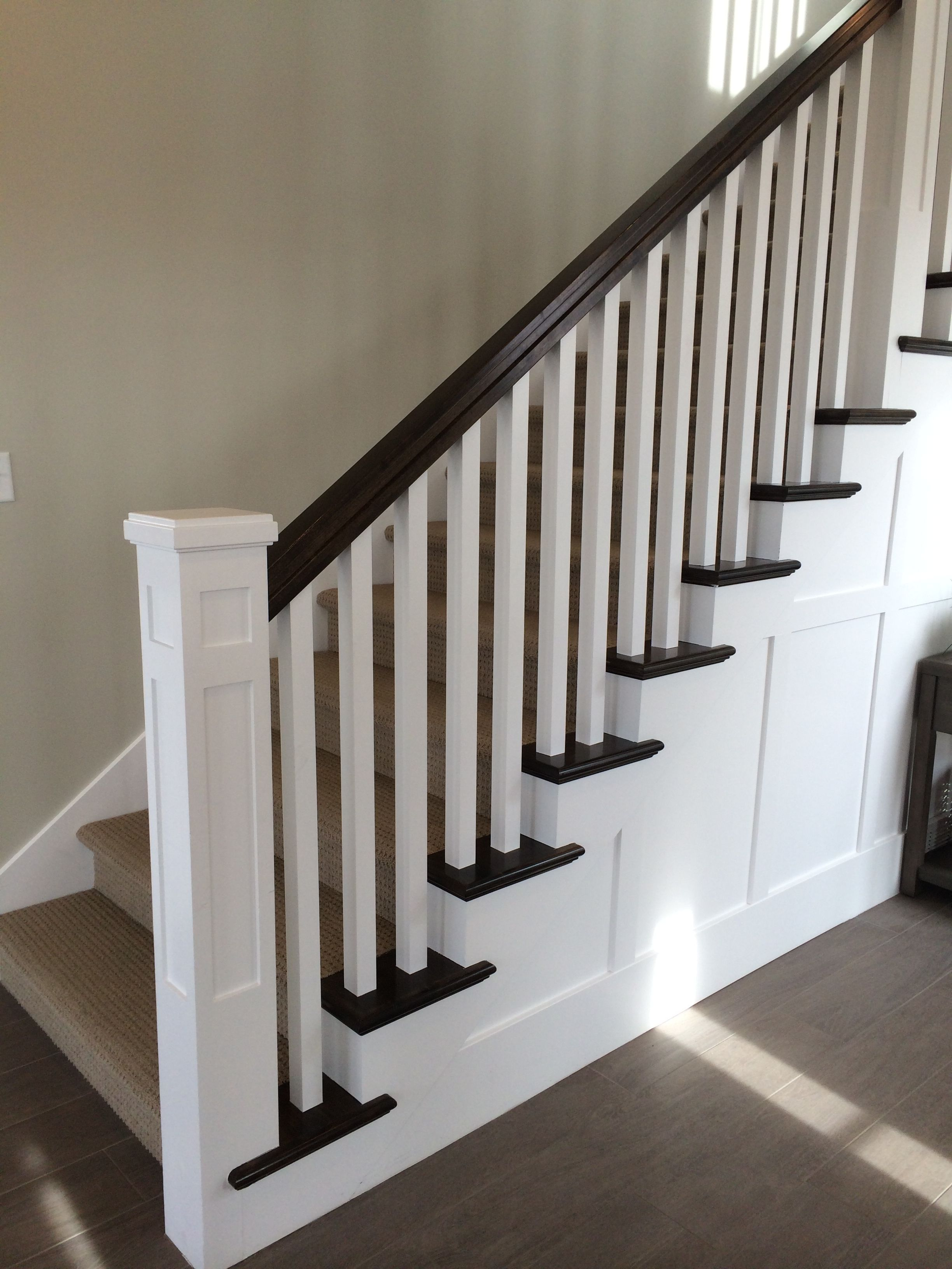 White newel post, charcoal stained handrail, white square