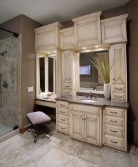 Bathroom vanity with built-in cabinets around mirrors ...