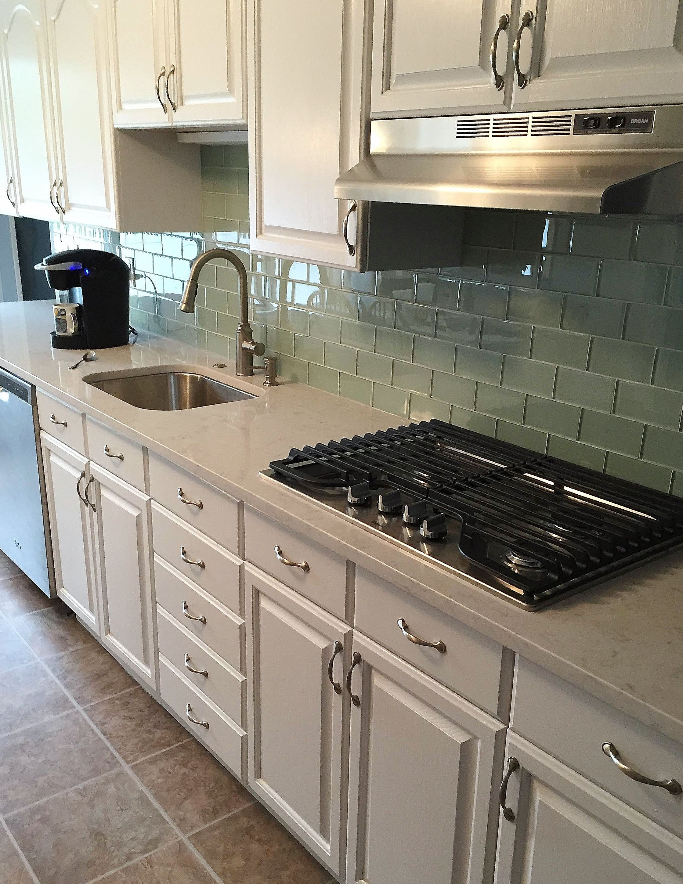 glass tile kitchen countertop armoire silestone lagoon quartz countertops with a soft blue