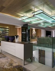 Open living space features  glass enclosed wine cabinet links and modern staircase which all three floors in this home cape town south africa also rh uk pinterest