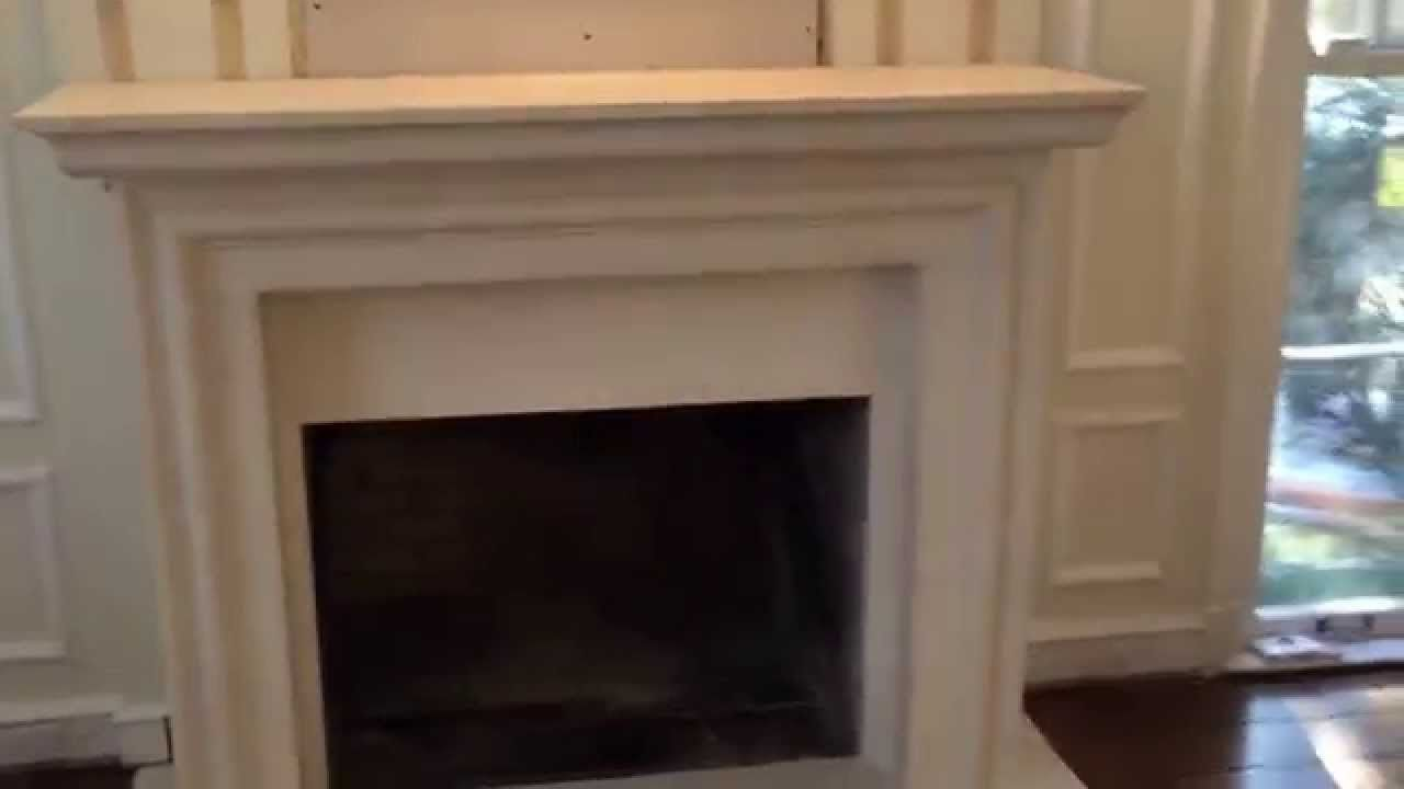 limestone fireplace surround with a wrap projecting off
