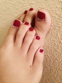 Deep red toes with little rhinestones on the big toes ...