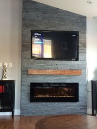 Grey stone fireplace with floating mantle electric