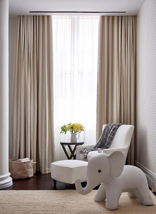 Beautiful White And Beige Nursery Boasts A Window Dressed In Sheer