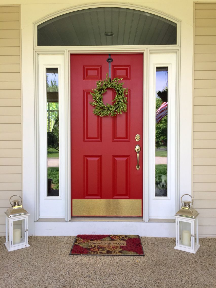 My farmhouse door painted from tan to red. Paint color