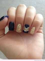 navy and gold glitter nail art