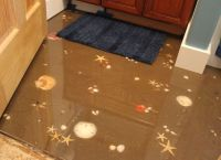 Sand and seashell floor with self leveling epoxy. Way cool ...