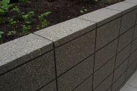 Honed Grey Coloured Masonry Retaining Wall Sealed In a Wet ...