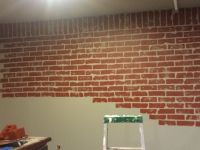 Faux brick wall in progress. Painted wall grey, then used ...