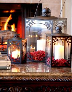 Gorgeous lanterns corated with candles  berries for christmas also rh pinterest