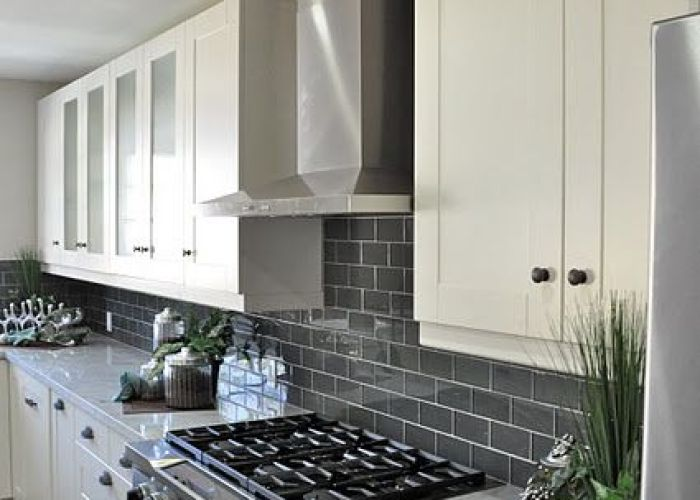 Gray subway tile backsplash for the kitchen white cupboards and also