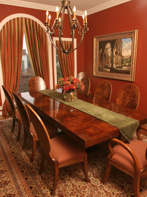 This Bold Dining Room Features Rust Colored Walls And Rust