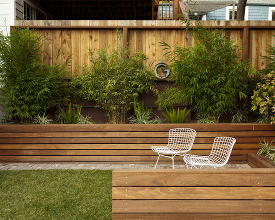 Beautiful Landscape Exterior With Wooden Retaining Walls And Patio