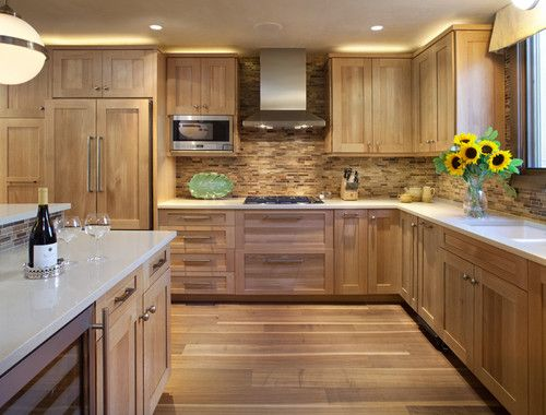 White Counter Top Textured Tile With Natural Oak Cabinets