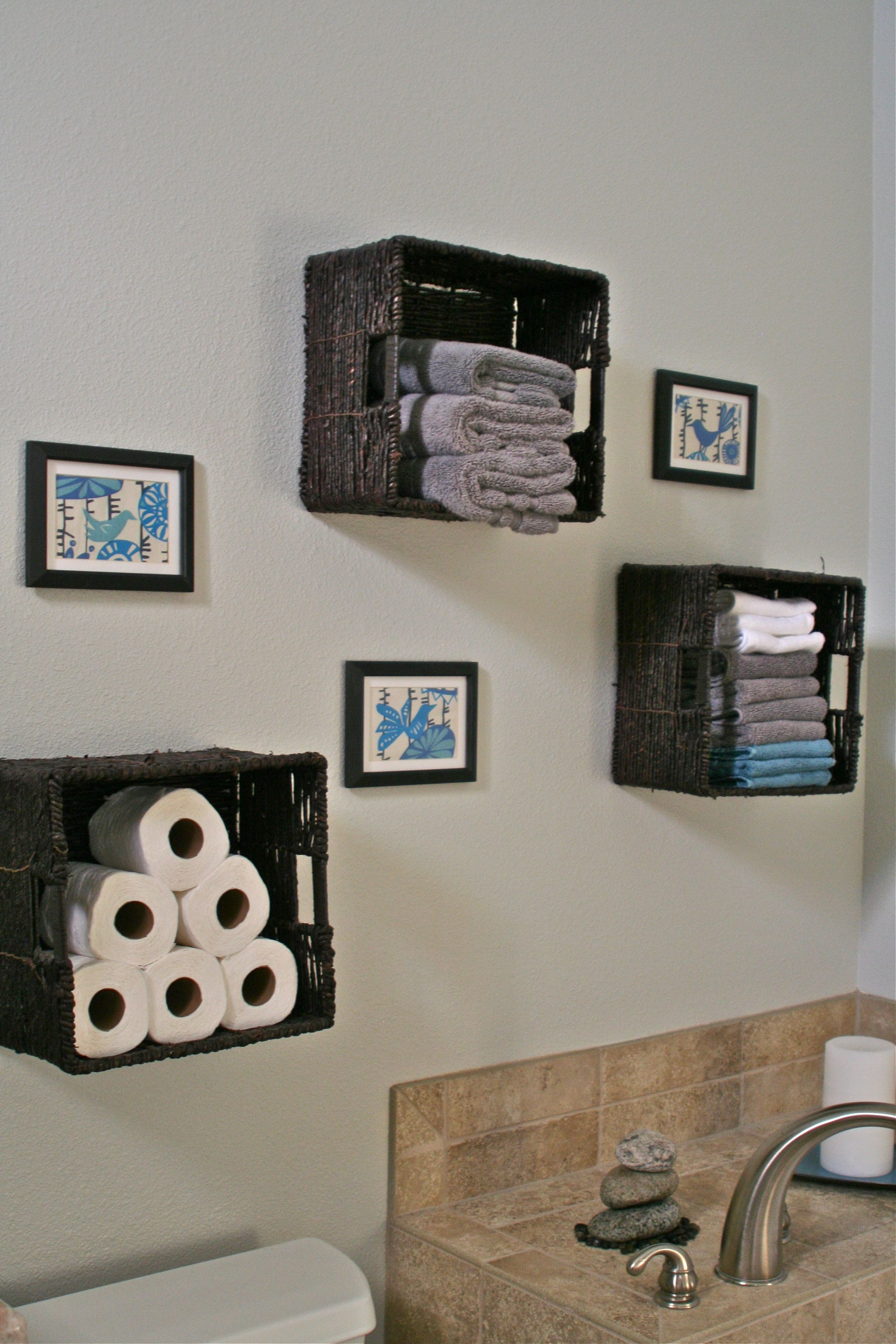 Instead of storing towels storage cloth diapers diy wall art basket pop blue in bathroom also baskets for toilet paper etc love the rh pinterest