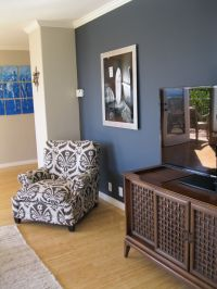 shade of blue on wall camoflauges tv. love the chair too ...