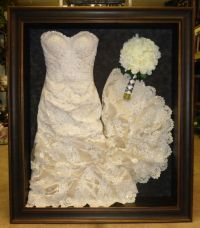 Framed wedding dress and bouquet framed by Floral