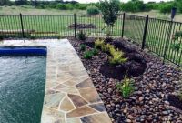Oklahoma Flagstone around pool with Arizona River Rock