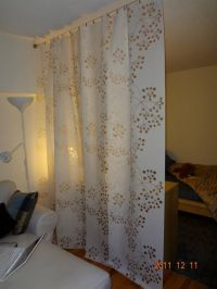 IKEA panel curtains hung on a wire curtain rod. Divider ...