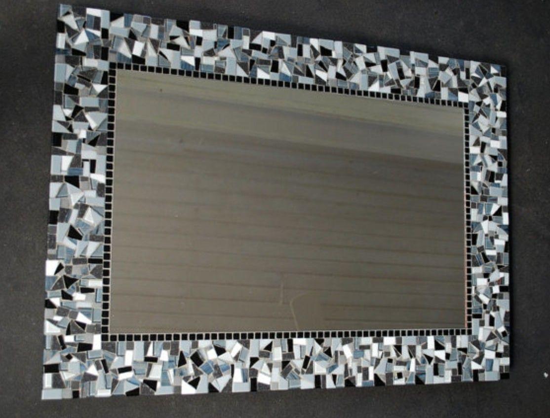 Mosaic around bathroom mirror