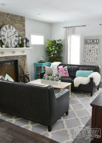 A traditional black and white living room with pops of ...