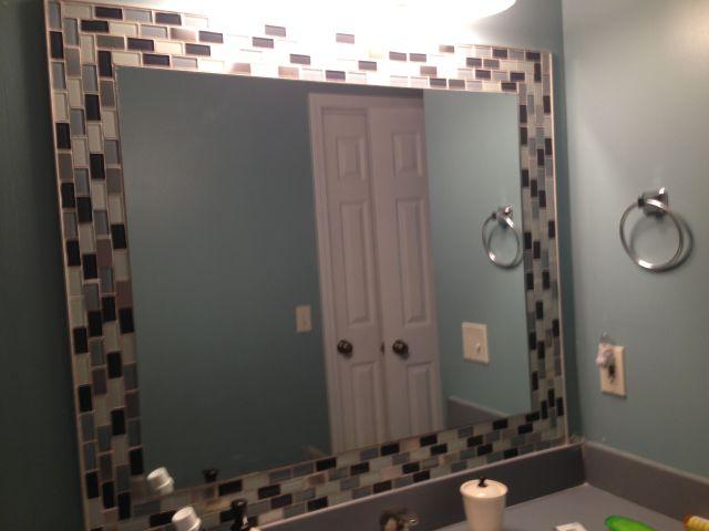Glass tiles around mirror Jazzes up any bathroom So easy